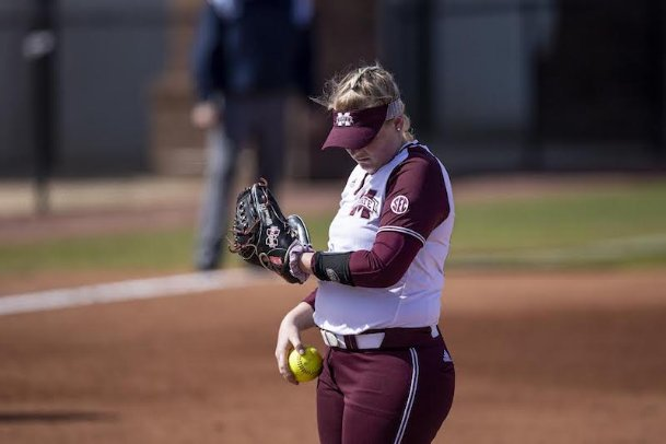 Emily Williams consults the scouting report during a home game against Southeast Missouri on March 7 at Nusz Park. Williams, who pitched a complete-game shutout, finished third nationally in ERA this season.