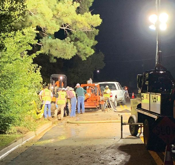Crews work overnight on a busted water pipe on Locksley Way in Starkville. The entire city is under a boil water notice until Saturday.