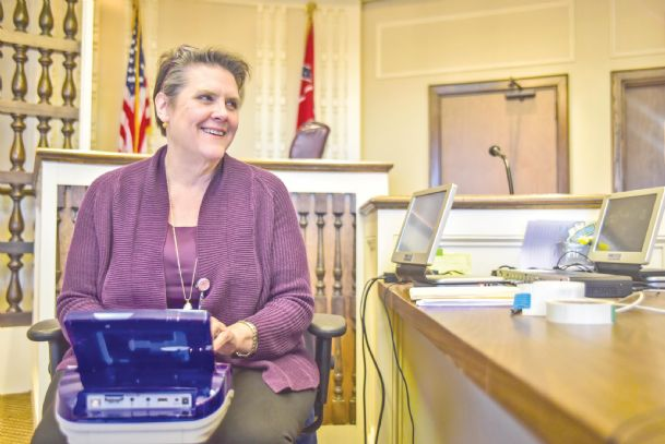 Melanie Morel, a court reporter for Clay County Circuit Court, poses in the Lowndes County Courthouse last week. Morel and other court reporters play an important part in making sure the justice system works, as they record — word for word — how trials play out.