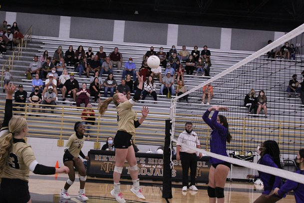 New Hope senior middle blocker Micaela Hudgins delivers a kill for the Trojans in the first set of Tuesday's first-round playoff match against Cleveland Central. The Trojans swept the Wolves and will face Center Hill on Saturday.
