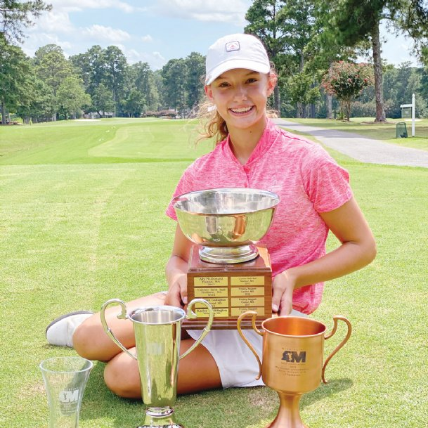 Emerson Blair poses with the championship trophy after winning the 2020 Mississippi Junior Amateur Championship in July at Northwood Country Club in Meridian. It was one of five events Blair won in 2020.