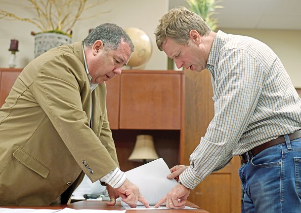 Lowndes sheriff candidate Eddie Hawkins and Lowndes supervisor candidate Trip Hairston look at election results as the precincts are counted Tuesday night at the Lowndes County Courthouse. Hawkins and Hairston both won their respective races by comfortable majorities.