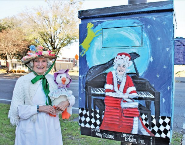 Mother Goose - Edwina Williams of Columbus - was surprised during the week of her Jan. 3 birthday with the dedication of a downtown utility box painted in her honor by Amy Ballard. The Adopt-A-Box beautification project, a Main Street Columbus initiative. began in 2019. Masks were removed only for photos.