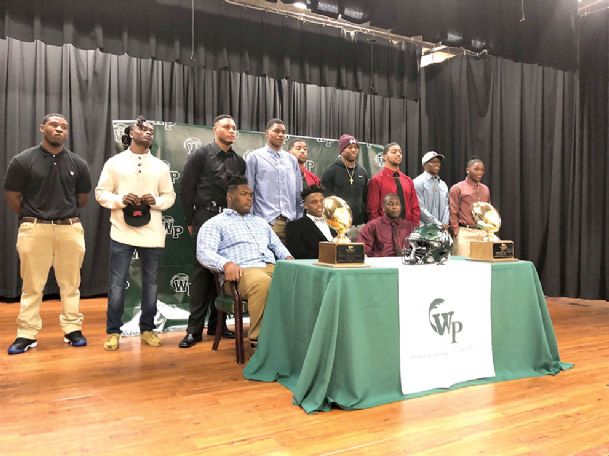 Twelve West Point High School football players have signed scholarship offers. Back row, from left: Archie Jones, Tray Brownlee, Ladarrius Glover, Jason Brownlee, Jameek Price, Marcus Murphy, Zameek Price, Chris Calvert, and Nate Montgomery. Front row, from left: Jamel Banks, Terence Cherry, and Rasson Carr.