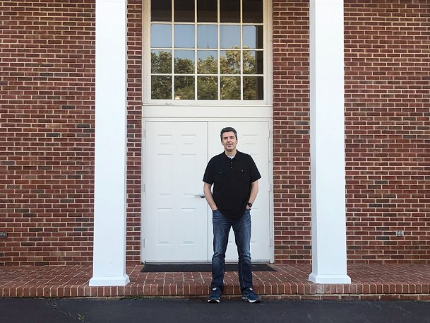 Todd Stevens, lead pastor at Mt. Vernon Church, stands in front of the church Monday evening. Stevens said the church is currently in the second step of a three-phase plan to reopen the church, but is uncertain when he will reopen it for in-person services.