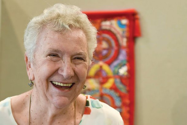 Folk artist Elayne Goodman of Columbus shares a laugh before the opening of her exhibition at the Columbus Arts Council Thursday. Whether creating unique artwork with found materials or painting objects with intricate patterns of dots,