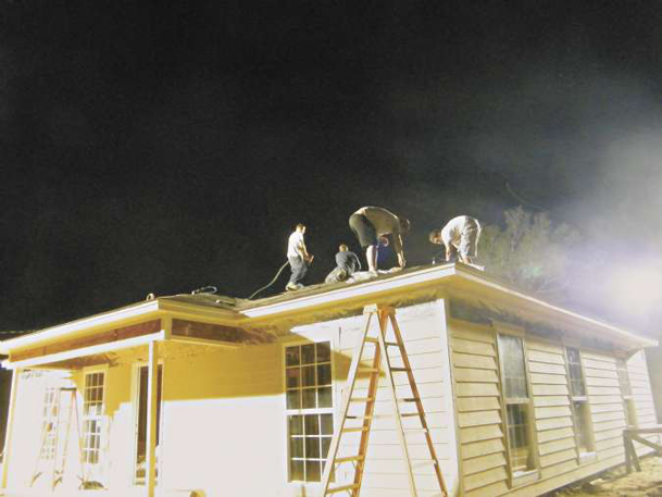 Volunteers work late into the night Sept. 28 to get a roof on the Columbus Lowndes Habitat for Humanity blitz build house virtually completed in nine days. Fairview Baptist Church partnered with Habitat for this fast-track project in west Lowndes County.