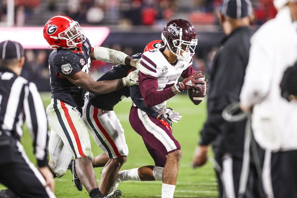 Georgia inside linebacker Monty Rice (32) takes down Mississippi State wide receiver Osirus Mitchell (5) during Saturday's game at Sanford Stadium in Athens, Georgia.