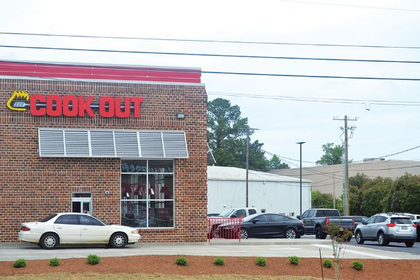 Customers line up for Cook Out on 18th Avenue North Wednesday afternoon in Columbus. The fast food restaurant officially opened Tuesday, offering hamburgers, barbecue, fries and more. This is the Golden Triangle's second Cook Out location with the Starkville restaurant opening in 2016.