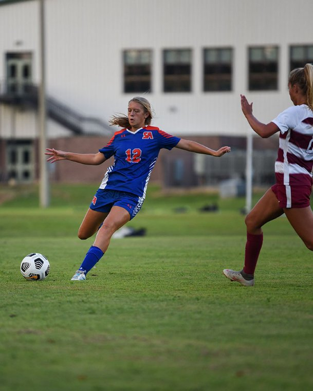 Starkville Academy sophomore Meredith Reed kicks the ball during a soccer game against Hartfield Academy on Tuesday in Starkville.