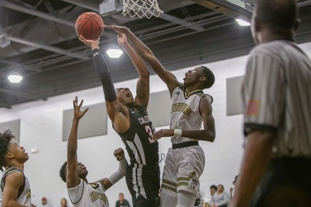 Caledonia senior Tyrin Johnson (32) has a shot blocked by New Hope senior Tikorian Chandler (3).