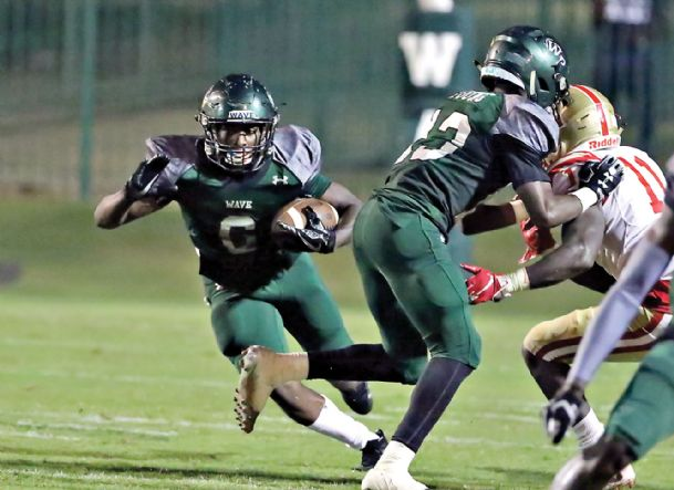 West Point High School running back Kameron Martin (6) gets running room as teammate Je'qwan Young (13) center blocks Lafayette's Quentin James (11) in the third quarter of their game Sept. 21 in West Point.