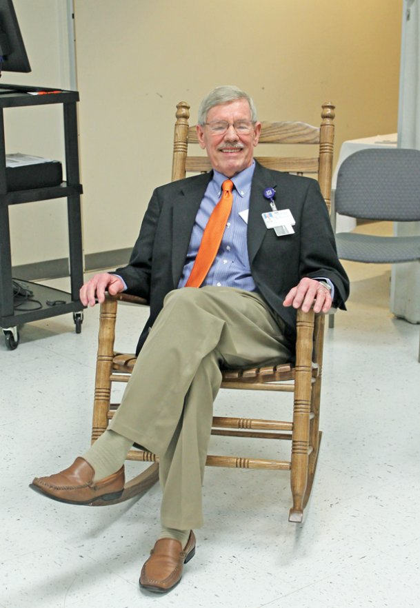 Baptist Memorial Hospital-Golden Triangle retiring Human Resources Director Bob McCallister tries out a new wooden rocking chair presented to him at his retirement reception Friday, Feb. 7 by the hospital's administrative team. McCallister recently retired after 19 years with the Baptist system. He became human resources director at Baptist Golden Triangle in January 2002. Associate Human Resources Director Jenni Gordman has been named to take his place.