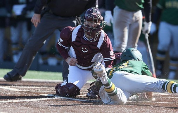 Mississippi State catcher Luke Hancock (20) tags out Wright State's Konner Piotto (23) during the third inning of their NCAA college baseball game Friday in Starkville.