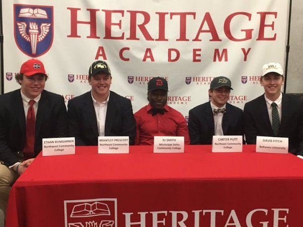 Heritage Academy seniors Ethan Bumgarner, Brantley Prescott, KJ Smith, Carter Putt and Davis Fitch all signed their letters of intent Wednesday.