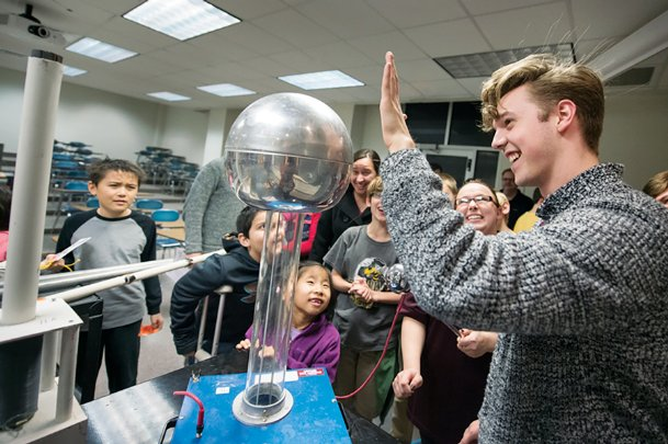Visitors to a past Science Night at the Museums event at Mississippi State are fascinated by a demonstration on static electricity.