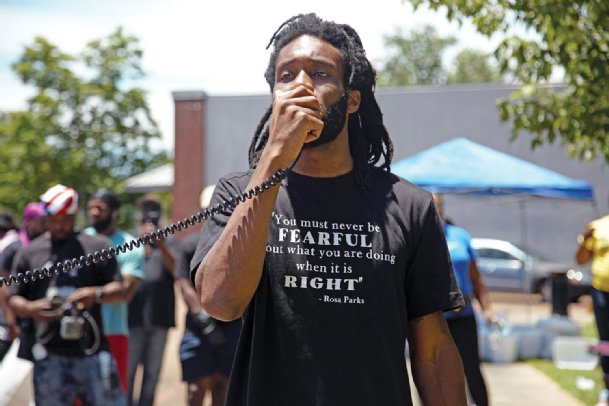 David Horton, of Columbus, holds up a megaphone to address a crowd of roughly 150 protesters in front of the city's police department Monday afternoon, demanding justice for Ricky Ball, a black man shot and killed in 2015 by white former police officer Canyon Boykin. The protest came days after state Attorney General Lynn Fitch dropped the manslaughter charge against Boykin and dismissed the case with prejudice. Many protesters criticized the timing of the dismissal, which coincides with the police killing of George Floyd in Minneapolis, an incident that has sparked national unrest.