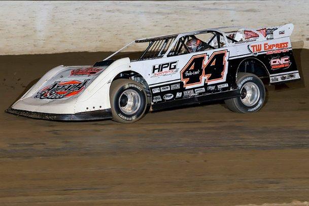 Brett White accelerates during his heat race Saturday night at Magnolia Motor Speedway.