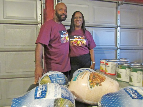 Johnny Hampton and Sherry Ellis have been stock-piling food in the garage of Hampton's East Columbus home as they prepare to deliver meals to as many as 500 people on Thanksgiving Day. Their decision to feed people came after city officials said they could not provide facilities that other Columbus volunteers have used to prepare and deliver Thanksgiving meals since 1994.