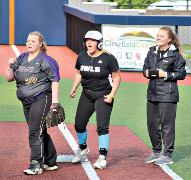 Kendall Wilkinson and Assistant Coach Noelle Winkles cheer at first base. Mississippi University for Women's softball team won its first game of the USCAA Small College World Series on Monday.