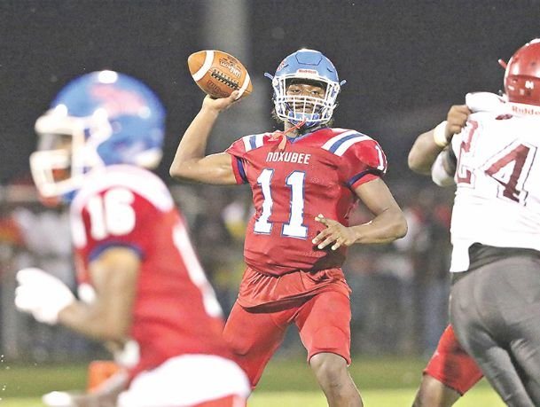 Noxubee County quarterback Marlon Windham prepares to pass the ball during the third quarter of the Tigers' game against Louisville on Aug. 23 in Macon.