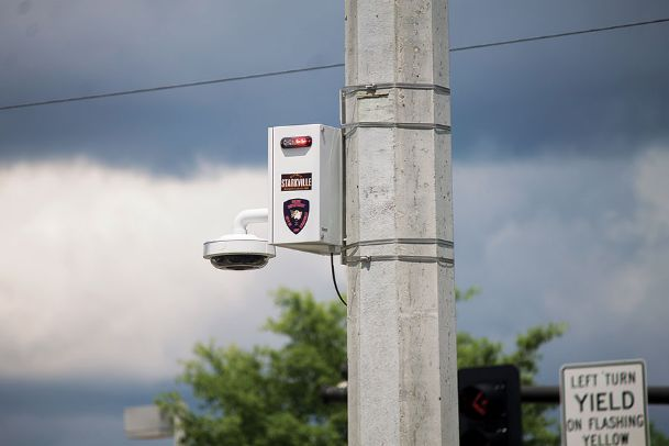 Starkville has installed security cameras around the city, such as this one at the intersection of Highway 12 and Montgomery Street. The city has fielded complaints about the cameras' flashing lights and concerns about privacy.
