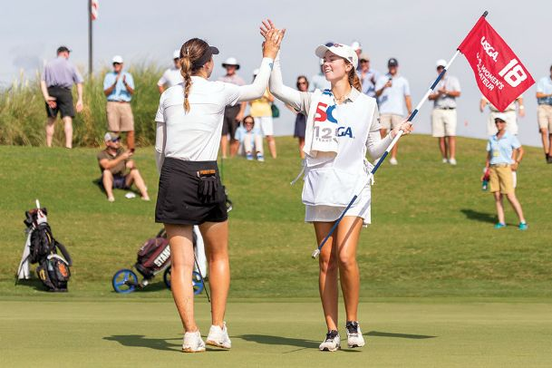 Blair Stockett, right, and Gabriela Ruffels celebrate the latter's victory on the 18th green at Old Waverly Golf Club in West Point during the 2019 U.S. Women's Amateur Sunday. Stockett took over carrying Ruffels' bag when her caddie departed.