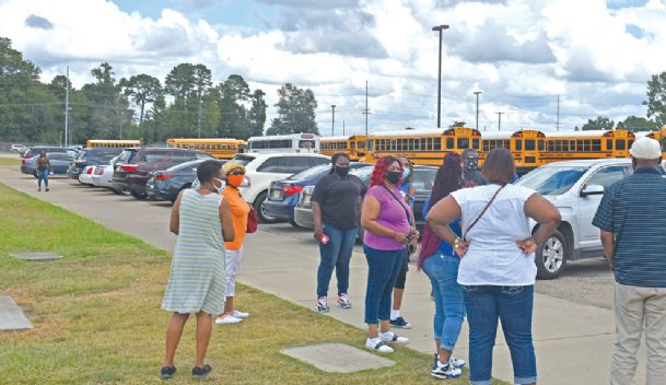 More than 20 Columbus Municipal School District bus drivers gathered Monday afternoon at the Columbus High School Sports Complex. Some of the drivers opted to strike, advocating for more compensation, and were later asked to move off school property.