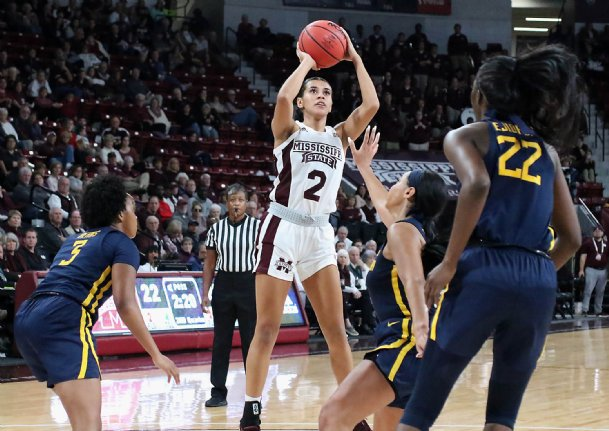 Andra Espinoza-Hunter takes a shot against West Virginia on Dec. 8, 2019 at Humphrey Coliseum.