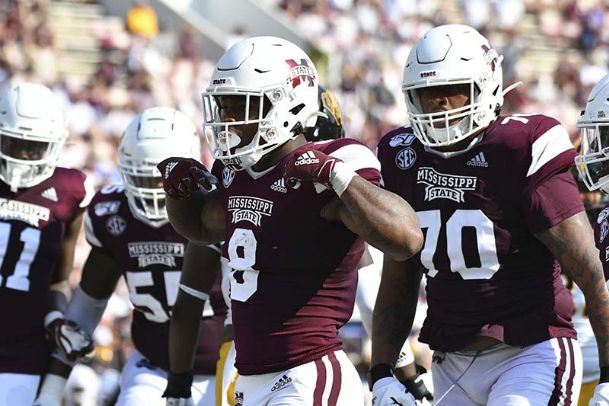 Mississippi State Bulldogs running back Kylin Hill (8) reacts with teammates after scoring a touchdown against the Southern Miss Golden Eagles during the third quarter Saturday at Davis Wade Stadium.