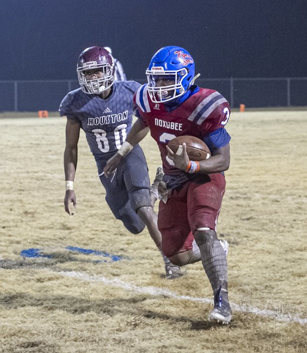 Noxubee County running back Bobby Shanklin runs the ball against Houston in the Tigers' 14-12 triple-overtime win in the Class 3A quarterfinals Nov. 22. in Macon