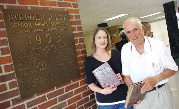 Lee alumna Jessica Howard Stephens visits the old Lee building with former Lee High School principal J.V. Carr in this 2010 Dispatch file photo. The Lee building is currently undergoing renovations to be turned into loft-style apartments, after developer Scott Berry purchased the property last year.