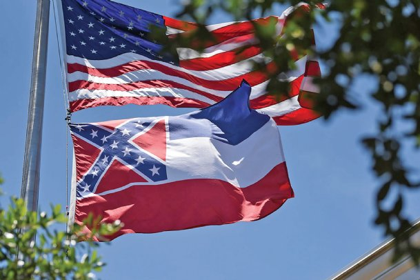 The Mississippi state flag flies over the Lowndes County Courthouse on Wednesday in Columbus. During the Jesus and Justice Rally outside the courthouse on Sunday, speakers said changing the state flag is one way to address systemic racism.