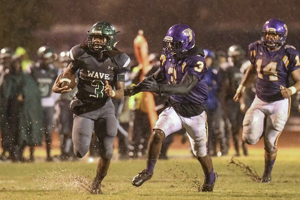West Point's Jimothy Mays (3) looks for room past Columbus' Kam Jenkins (3) in the second quarter Oct. 25, 2019, in Columbus. The Green Wave will host the Falcons on Friday in West Point as both teams look to snap losing streaks.
