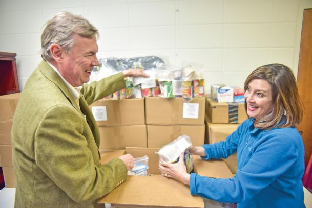 Lee Burdine, left, and the Rev. Sandra Brown unload boxes of healthy snacks for school children Thursday at First United Methodist Church in Columbus. It is just one way these Team HOPE members express concern for community health and well-being. The team will sponsor its first Golden Triangle Region Community Health Fair Saturday, Feb. 28, from 10 a.m. to 2 p.m. at the church located at 602 Main St. in downtown Columbus. It will be, they hope, the start of something big.