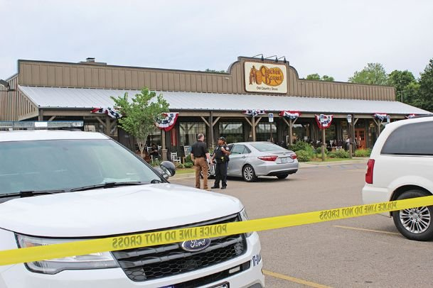 Law enforcement officers talk outside Cracker Barrel on 18th Avenue North following a shooting inside the restaurant.