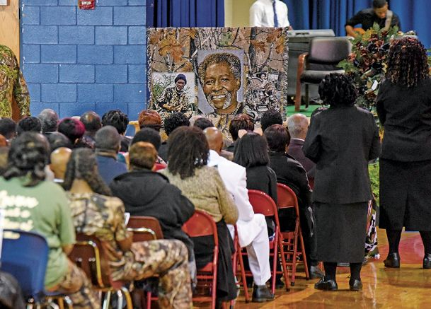 Family and friends gather for a celebration of life remembering Levon Brooks at Noxubee County High School Saturday morning. Many wore camouflage as an acknowledgment to Brooks' love of hunting. Brooks was exonerated in 2008 after 18 years spent in prison for a murder he did not commit.