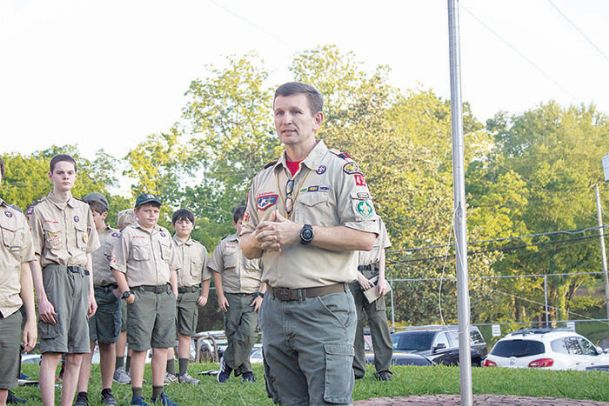 """Troop 45 Scoutmaster Jason Tiffin talks about the """"Save the Hut� campaign during a Monday dedication ceremony. The troop held the ceremony to celebrate the completion of a renovation to its scout hut near First United Methodist Church."""