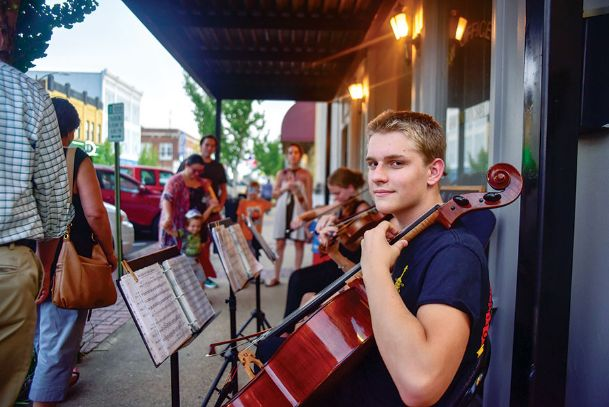 Scott Sandifer, 17, plays his cello with the Suzuki Strings of Columbus players in front of downtown store fronts during the 2017 Art Walk in this Dispatch file photo. Scott is the son of Ricky and Denise Sandifer of Columbus.