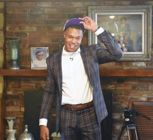 Mississippi State standout Robert Woodard II tries on the Sacramento Kings hat for the first time after being drafted Wednesday. Woodard II is the first Columbus-born player taken in the NBA draft since 1985.