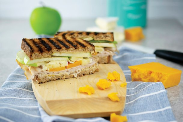Dijon mustard, Granny Smith apples, Brie, cheddar cheese and more turn a sandwich into something special.