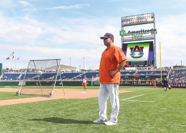 Auburn head baseball coach Butch Thompson watches his team practice Friday in Omaha, Nebraska. The Aberdeen native and former Mississippi State assistant will lead his Tigers against the Bulldogs tonight in the College World Series.