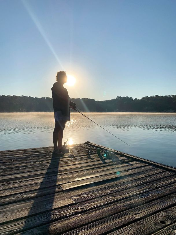 Lowndes County Sheriff's Office Lt. Tammy Prescott fishes off a dock at Smith Lake in Alabama earlier this year. Prescott died Friday, at age 57. She was known throughout the community for her volunteer work and community service, especially at Camp Rising Sun.