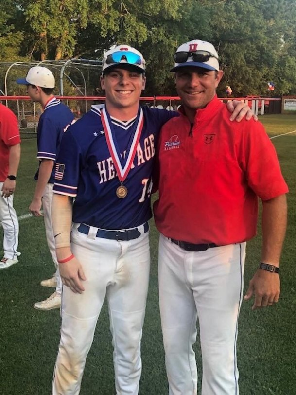 Chris Ball (right) was hired as Heritage Academy's new head baseball coach Wednesday. Ball served as an assistant under head coach Justin Flake this season.