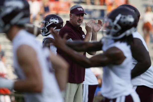 Mississippi State Bulldogs head coach Joe Moorehead watches his during warmups before the game against the Auburn Tigers Saturday at Jordan-Hare Stadium.