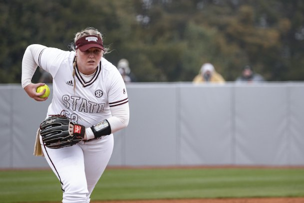 Mississippi State senior Emily Williams throws a pitch during the first game of a Feb. 13 doubleheader against Miami (Ohio) in Starkville. Williams and fellow Bulldogs ace Annie Willis were shaky in cold temperatures against the RedHawks and will have to improve to avoid another scare this weekend.