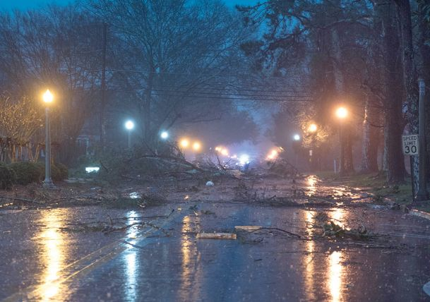 Trees and debris cover College Street after a storm rolled through downtown and East Columbus on Saturday.