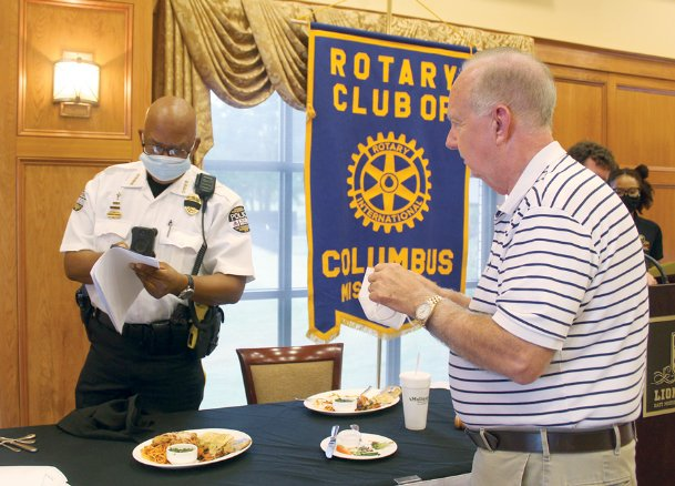 Columbus Police Chief Fred Shelton speaks with Rotary Club member Dr. James Brooks after the club's weekly meeting at Lion Hills Center Tuesday. Shelton spoke to the club about community policing and his plans for a police athletic league, in which officers with play sports with teenagers to foster relationships and help keep teenagers out of trouble.