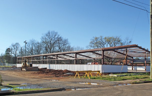 The frame of the new 9,000-square-foot community center at Sim Scott Park is in place, and Mayor Robert Smith expects the building to be complete this year. The park was devastated and former community center destroyed in an EF-3 tornado that hit Columbus a year ago today. Precision Metal is rebuilding the new center.