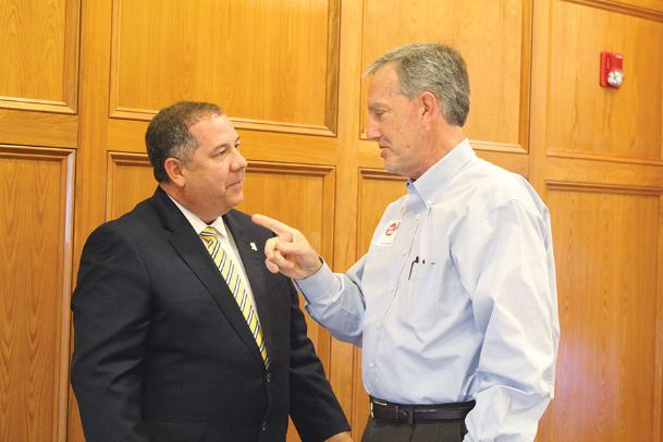 Mississippi Bureau of Narcotics Lt. Eddie Hawkins, left, speaks with Rotary Club member Roger Burlingame after a club meeting at Lion Hills Center Tuesday. Hawkins spoke to Rotary Club about drug trends throughout the state and country.